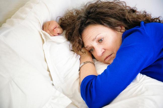 donna stanca al letto.jpg